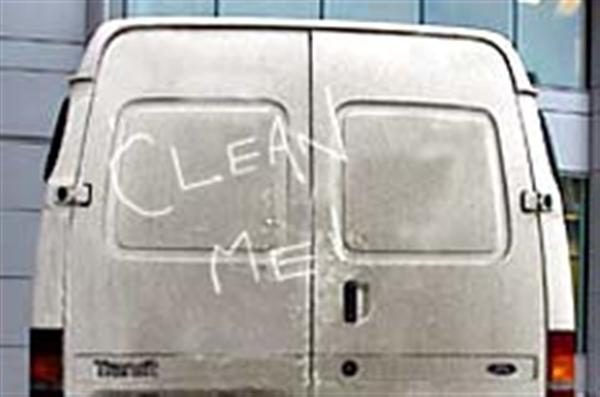 White van with 'clean me' written in dirt on the back door