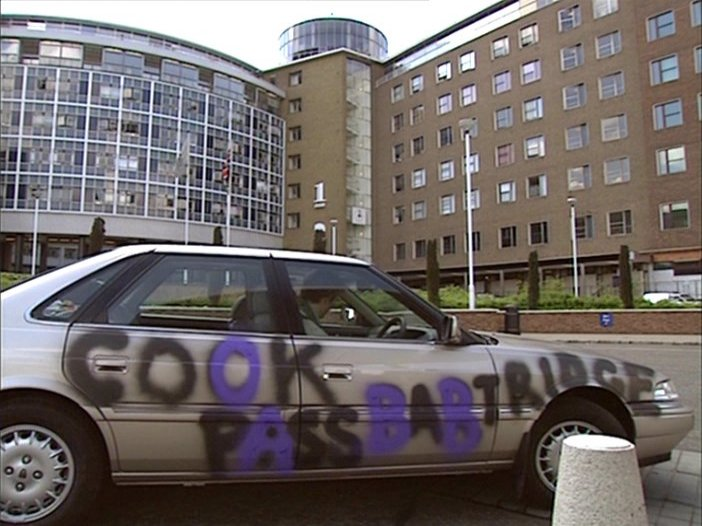 Alan Partridge's vandalised car from I'm Alan Partridge. The graffiti reads 'cook pass babtridge' as he's painted over some of the letters to obscure the original vulgar sentiment.