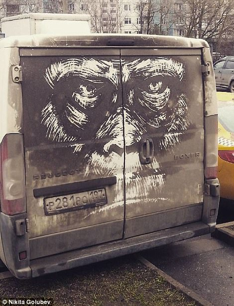 Van with artwork of gorilla drawn in dirt